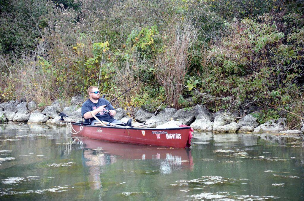 Canoe Fisherman