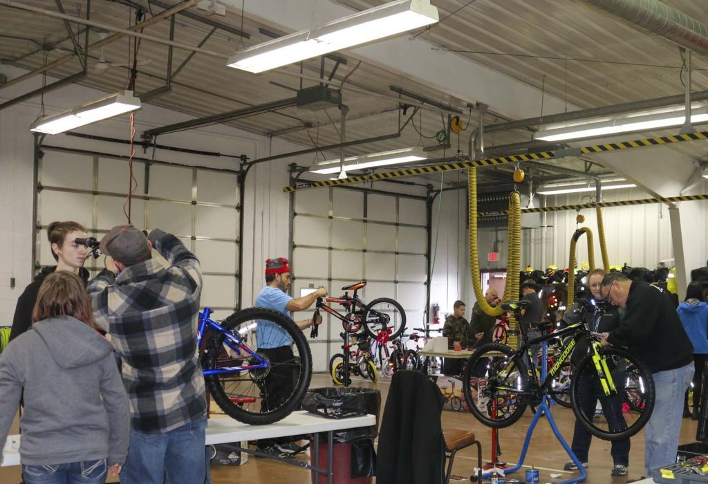 volunteers fixing bikes